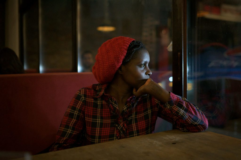 Maureen (33), a Masters student and journalist from Nairobi, Kenya, in a popular student hangout near the American University in Kirenya/Girne.