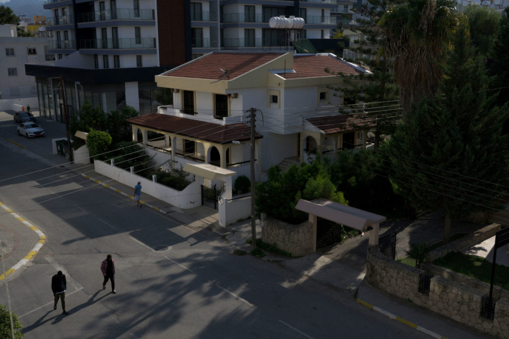 Two Africans are walking the streets of a middle class neighbourhood in Kyrenia, Norther Cyprus